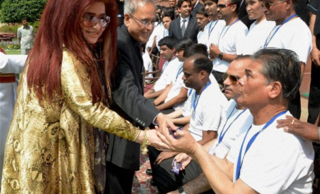 Beautician Shahnaz Husain introduces her visually challenged students to President Pranab...