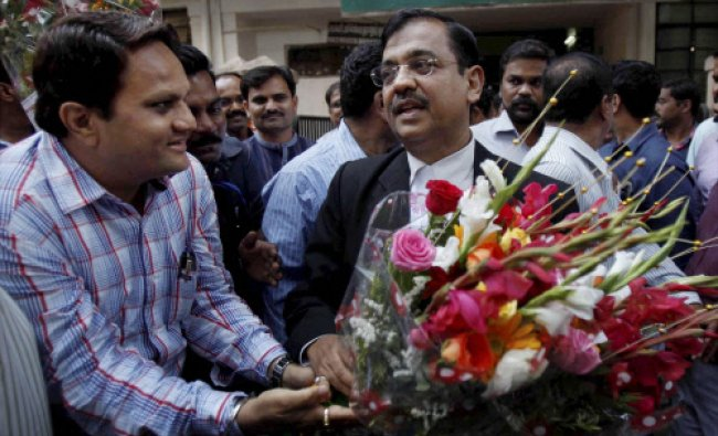 Public Prosecutor Ujjwal Nikam presented with flower bouqet as he comes out of a court in Mumbai...
