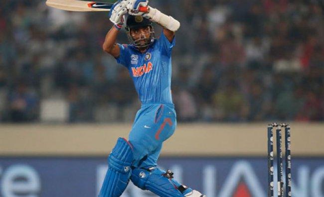 Ajinkya Rahane plays a shot during their ICC Twenty20 Cricket World Cup semifinal match against...