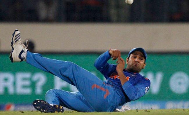 Yuvraj Singh throws the ball as he fields during their ICC Twenty20 Cricket World Cup semifinal...
