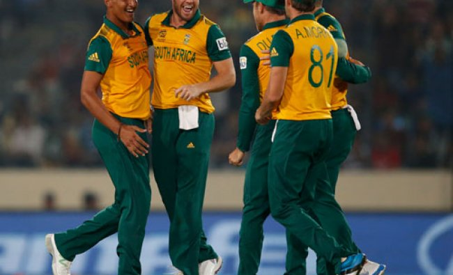 South Africa\'s bowler Beuran Hendricks, left, celebrates with teammates the dismissal of Rohit...