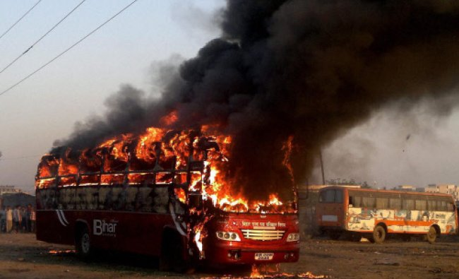 A bus catches fire near Mithapur bus stand in Patna on Friday. PTI Photo