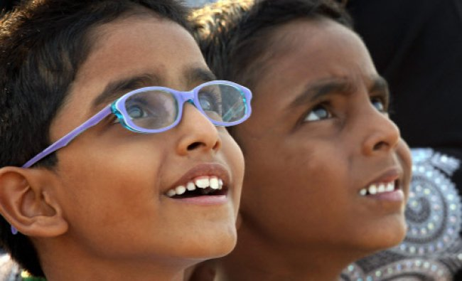 Children look at PSLV C24 after it was launched at Sriharikota in Andhra Pradesh on Friday...