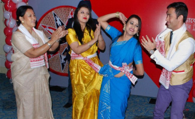 Actress Nishita Goswami, Barsha Rani Bishoya and actor Nayan Nilim perform Bihu dance at an...