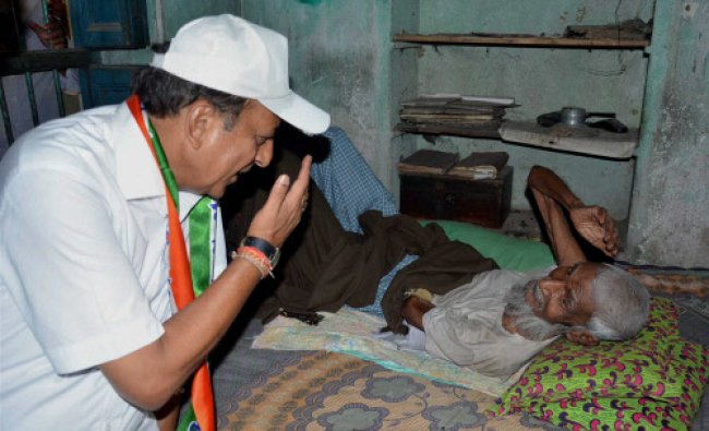 TMC candidate Dinesh Trivedi from Barrackpore interacts with an old voter during his election...