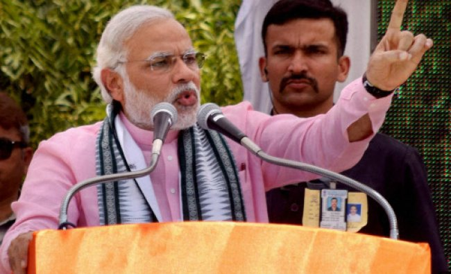 BJPs Prime Ministerial candidate Narendra Modi addressing durign an election campaign rally at...