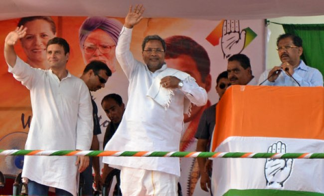 AICC Vice President Rahul Gandhi and Chief minister Siddaramiah are waves to peoples at a public...