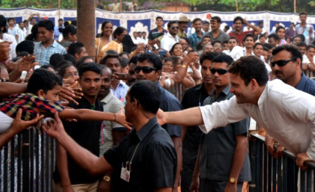 AICC Vice President Rahul Gandhi stretches out to greet a supporter during an election rally at...