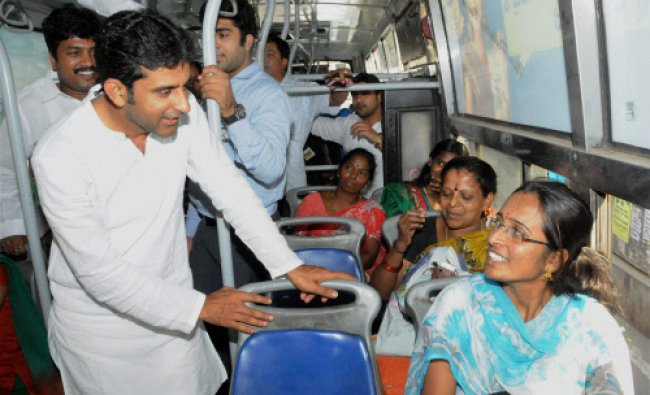 Congress candidate from Bangalore Central, Rizwan Arshad interacts with bus passengers during...