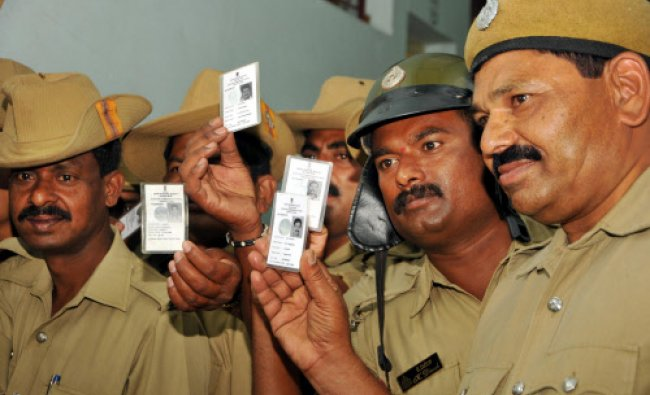 State Reserve Police mens display their Election ID during Postal Voting at KSRP in Mysore on...
