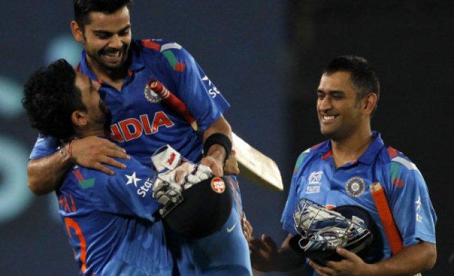 India\'s Yuvraj Singh congratulates Virat Kohli after India won the semi- final against S.Africa...