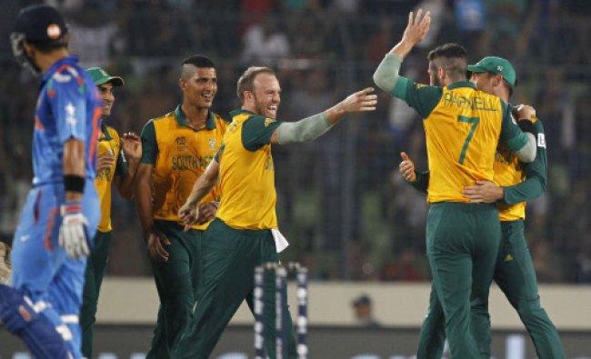 South Africa\'s players clebrate the dismissal of India\'s Ajinkya Rahane...
