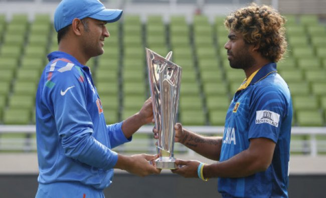 Mahendra Singh Dhoni and Lasith Malinga pose together for the winner trophy...
