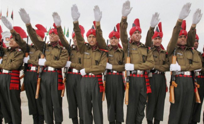 Army recruits taking oath during a passing out parade at Jammu and Kashmir Light Infantry...