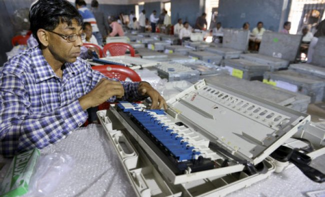 Poll employees check the EVM\'s ahead of upcoming Loksabha Election in Bhopal...