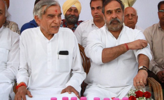 Union minister and Congress leader Anand Sharma and party candidate Pawan Kumar Bansal...