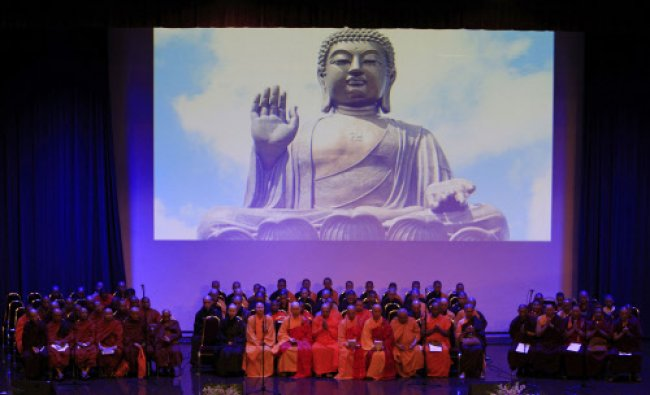 Buddhist monks offer prayers during a mass prayer for the missing Malaysia Airlines Flight MH370...