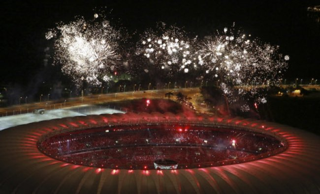 An aerial view shows fireworks over the Beira-Rio stadium during its opening ceremony in Porto...