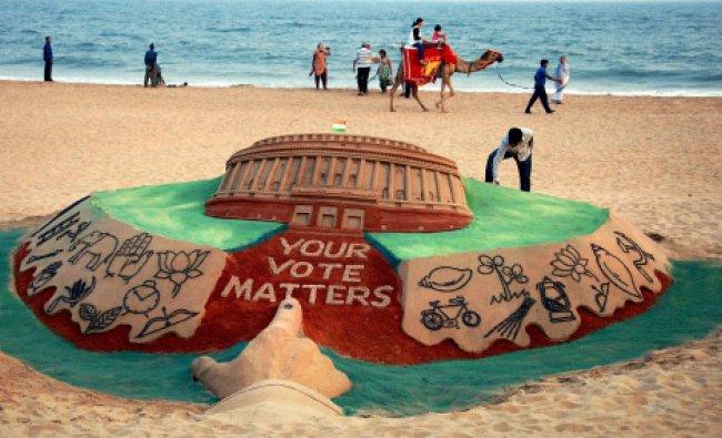 Sand artist Sudarsan Pattnaik creates a sand sculpture on upcoming election...