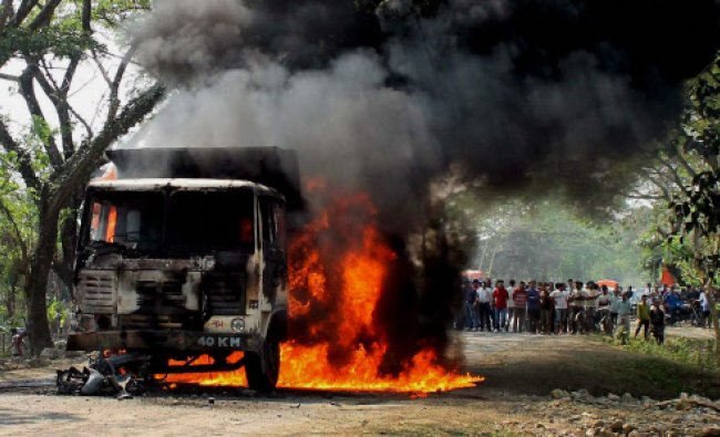 People set ablaze a dumper after it hit a boy on a scooty to death...