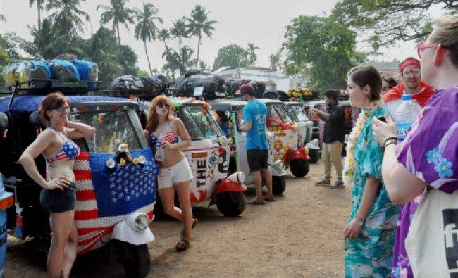 Participants of \'Rickshaw Run\' before their annual race...
