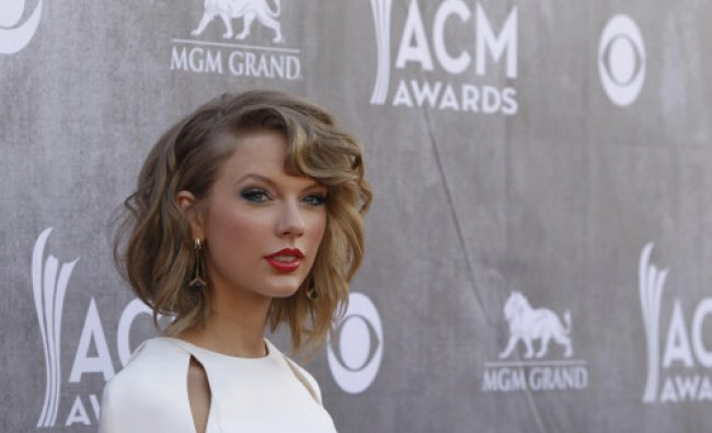 Country music artist Taylor Swift arrives at the 49th Annual Academy of Country Music Awards in...