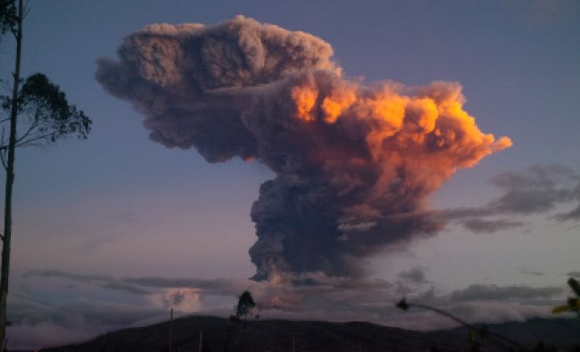 In this Friday, April 4, 2014 photo, the Tungurahua volcano spews a column of ash as seen from...