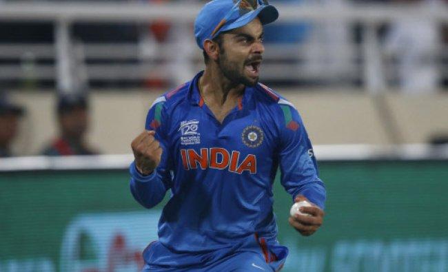 Virat Kohli celebrates taking the catch to dismiss Sri Lanka\'s batsman Tillakaratne Dilshan...