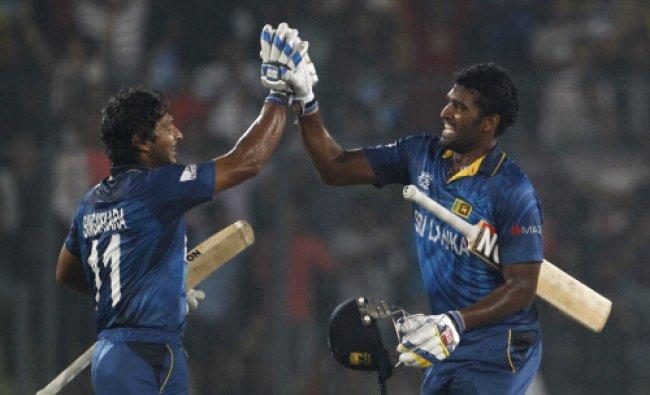 Kumar Sangakkara, and Thisara Perera celebrate after winning the Twenty20 Cricket World Cup final...