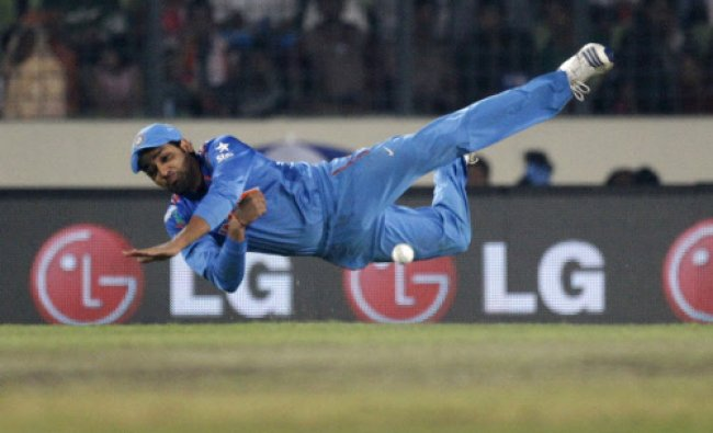 Rohit Sharma throws the ball as he fields during their ICC Twenty20 Cricket World Cup final match...