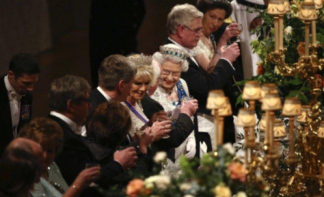 Britain\'s Queen Elizabeth II and Ireland\'s President Michael D. Higgins toast after speeches...