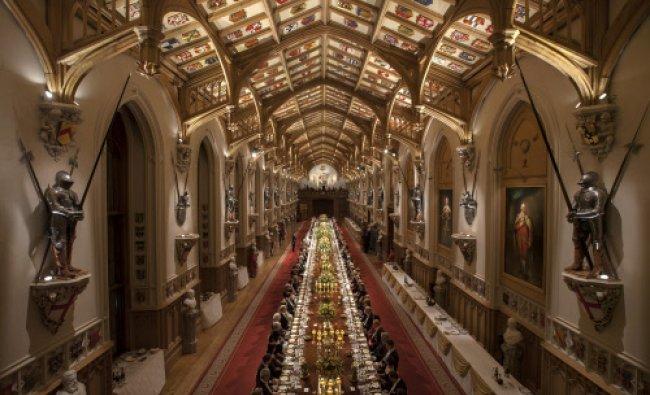 Guests listen during a speech by Britain\'s Queen Elizabeth II in honour of Ireland\'s President...