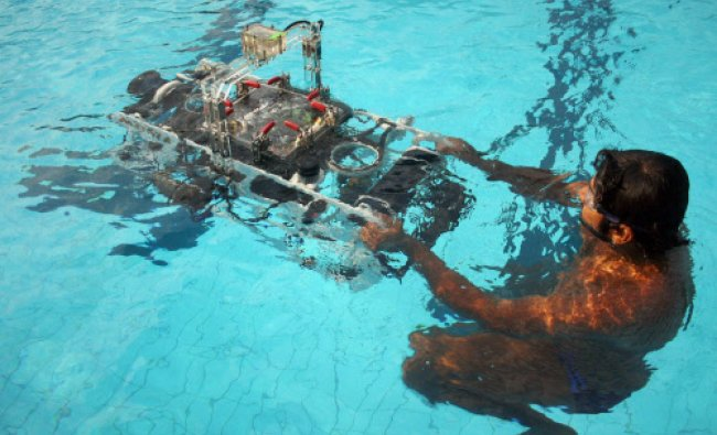 Students demonstrate \'Matsya\' underwater robotic vehicle during the unvieling at...