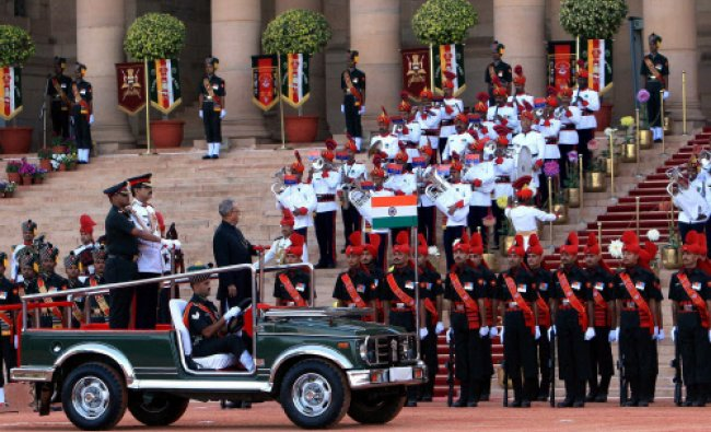 President Pranab Mukherjee inspects guard of honour at the special show of Change Over...