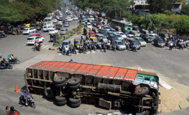An overturned truck at an expressway service lane near Rajiv chowk, Gurgaon...
