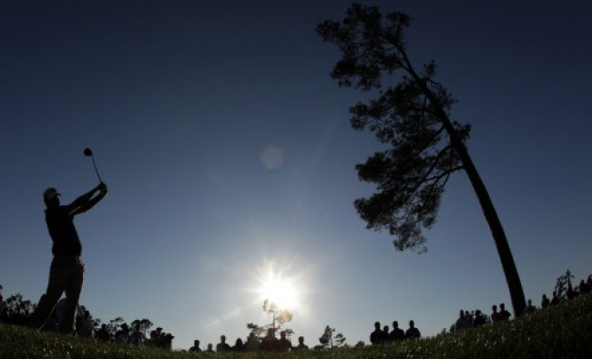 Marc Leishman, of Australia, tees off on the 18th hole during the first round of the Masters...
