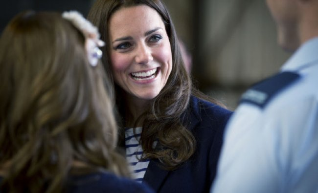Britain\'s Kate, the Duchess of Cambridge smiles as she meets families of the Royal New Zealand...