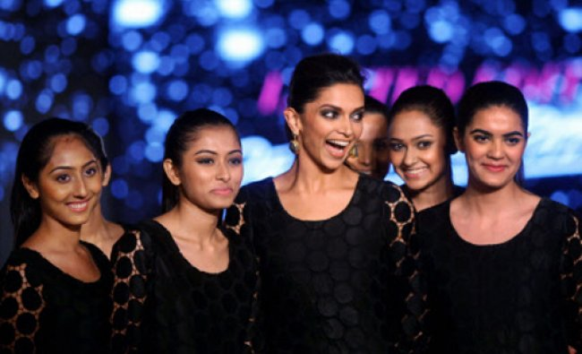 Deepika Padukone walks the ramp with her fans to showcase a designer outfit in Mumbai. PTI Photo