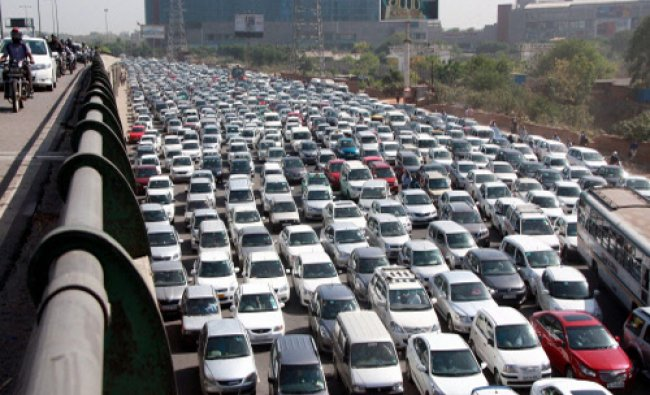 Vehicles stuck in a heavy traffic jam at Shankar Chowk in Gurgaon on Friday. PTI Photo