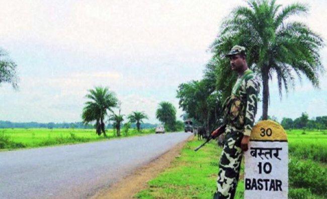 A jawan keeps tight vigil during the Lok Sabha election near Bastar, Chhattisgarh on Thursday...
