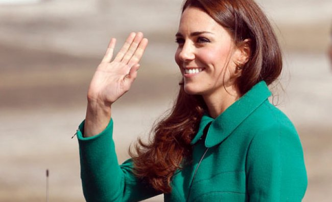 Britain\'s Catherine, Duchess of Cambridge, waves after arriving with Prince William at Hamilton...