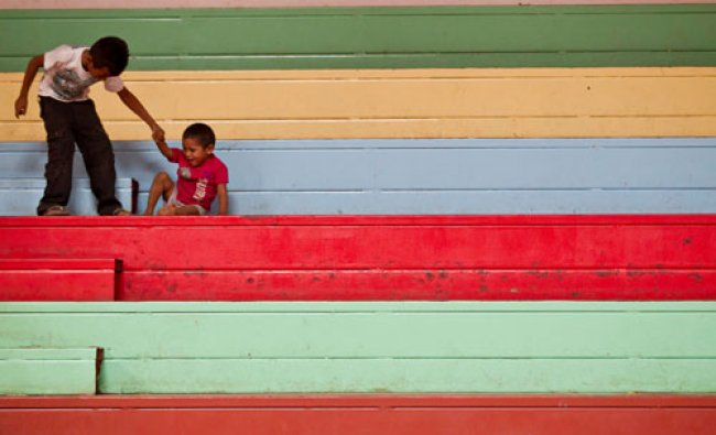 Two boys play inside a shelter for people displaced by a 6.1-magnitude quake, in Managua...