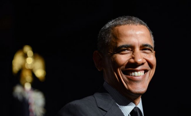 President Barack Obama smiles while speaking at the National Action Network conference Friday...