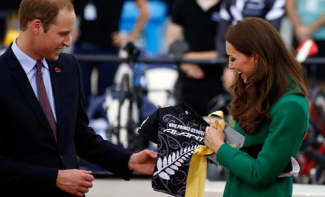 Britain\'s Prince William and his wife Catherine, Duchess of Cambridge, are presented with a...