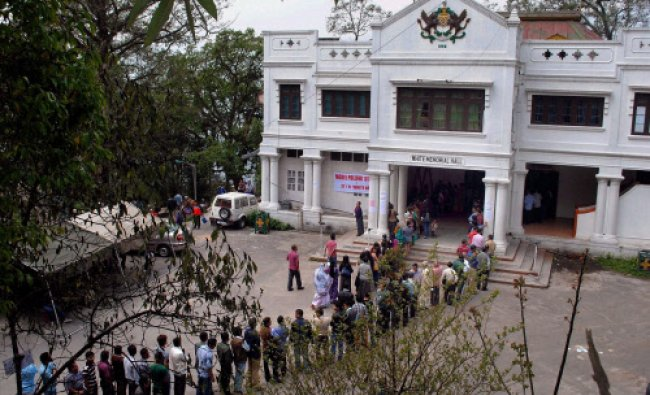 People wait in a long queue to cast their votes for Lok Sabha and Assembly polls in Gangtok...