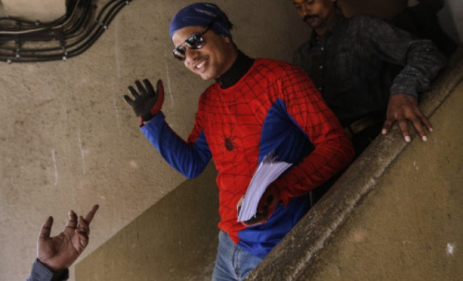 Gaurav Sharma, an independent candidate also known as the Indian Spider-Man, waves at residents...