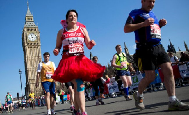 Participants run past the Palace of Westmister during the London Marathon April 13, 2014. REUTERS