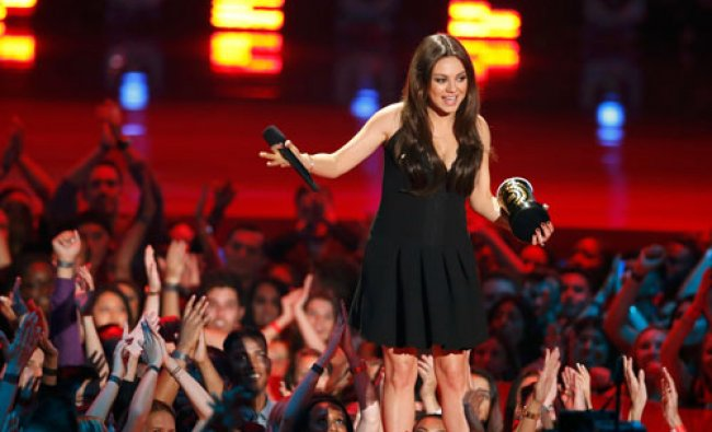 Mila Kunis accepts the award for best villain for her performance as Theodora, Wicked Witch of...