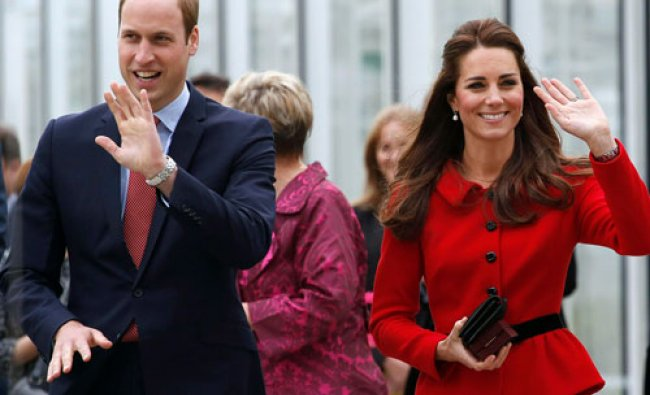 Britain\'s Prince William and his wife Catherine, Duchess of Cambridge wave to the crowd as they...