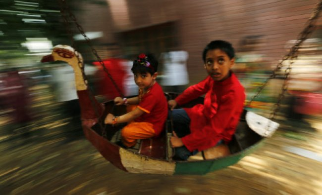 Children ride a carousel as they celebrate Pohela Boishakh, the first day of the Bengali new year...